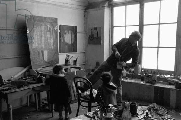 Terry Frost with two of his five young sons in his St. Ives studio, Cornwall (b/w photo)