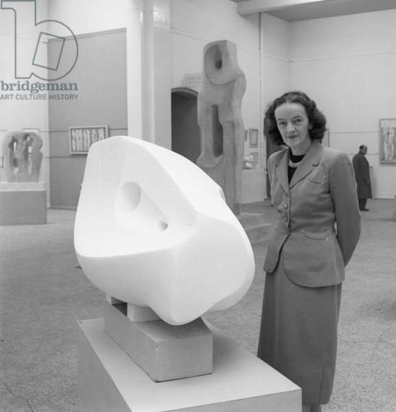 Barbara Hepworth at a showing of her work in London, early 1950s (b/w photo)