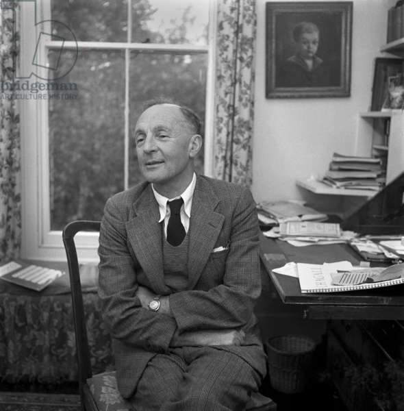 Joyce Cary in his home office in Oxford, 1951 (b/w photo)