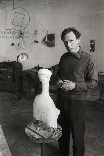 Reg Butler in his St. Ives studio, Cornwall, 1954 (b/w photo)