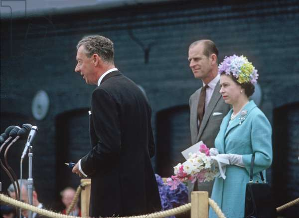 Benjamin Britten at the microphone with HM Queen Elizabeth II and Prince Philip nearby on the occasion of the opening of the Snape Maltings Concert Hall, Aldeburgh, Suffolk, June 2, 1967 (photo)