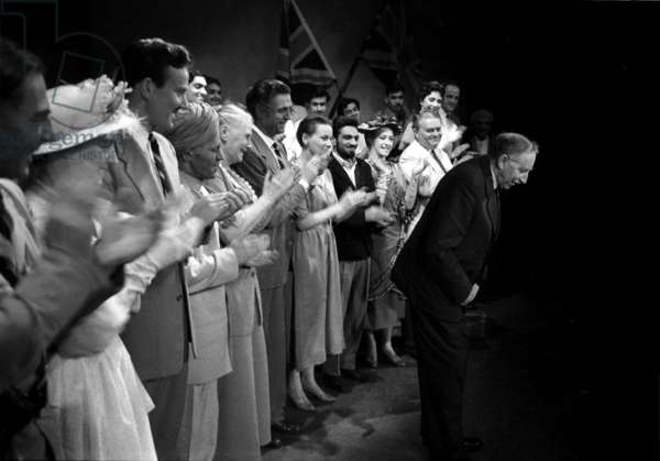 E.M. Forster takes a bow on stage following a performance of 'A Passage to India', April 1950 (b/w photo)