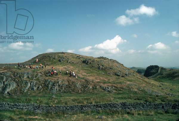 Hadrian's Wall with hikers near Twice Brewed, England (photo)