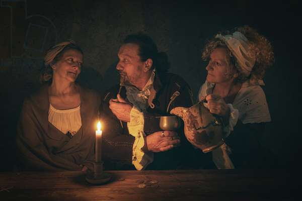17th century, North Italy: country militia. Reconstructive hypothesis civil and military uses and customs. Seduction game by candlelight, Verrua Savoy, Turin, Piedmont, Italy (photo)