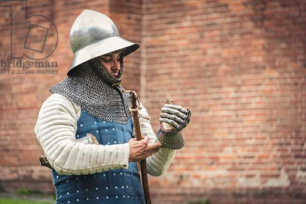 Second half of the 14th century: Portrait of a man of arms with helmet, gambeson and brigantine, Marimondo, Milan, Italy (photo)