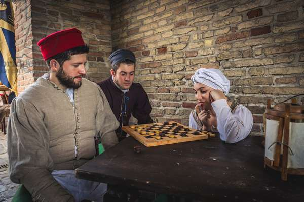 On a hot summer afternoon, under a porch you play checkers, Hypothesis reconstructive uses and customs Middle Ages Italy, Mondaino, Italy (photo)