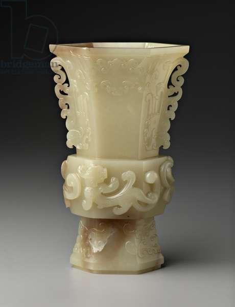 Gu-shaped vase with designs of bat, chi-dragon, and phoenix, 18th century (yellow jade)