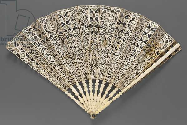 Découpé folding fan, c.1590-–1600 (carved ivory sticks & cut skin leaf with silk plain weave and mica inserts)