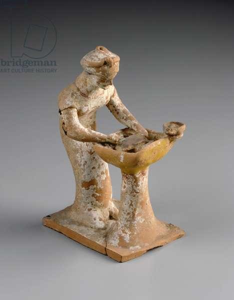 Figurine of a woman kneading dough at trough, Archaic Period, c.500-475 BC (terracotta)