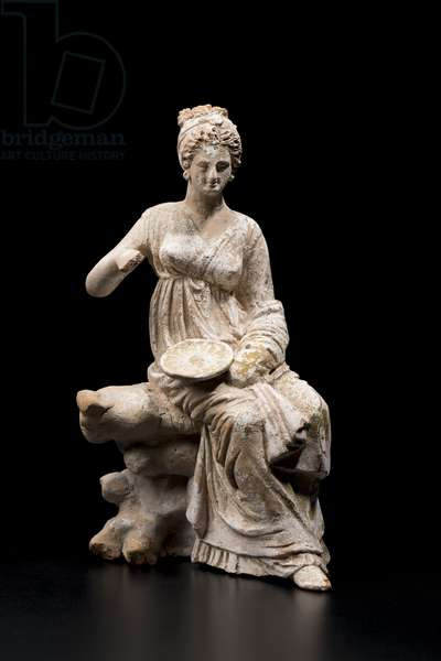 Woman seated on a rock holding a phiale (libation bowl) (terracotta)