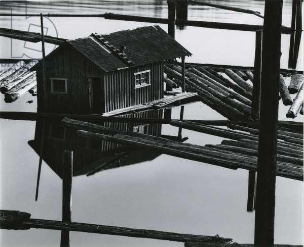 Logs, Building, Water, 1982 (silver gelatin print)