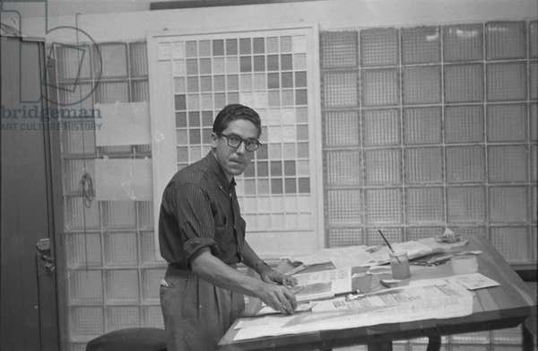 Carlos Cruz-Diez at the graphic studio of the magazine Momento, Caracas, Venezuela, 1957 (b/w photo)