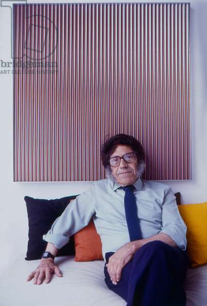 Carlos Cruz-Diez in front of a Physichromie in his studio in Chapellín, c.1980