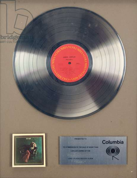 An RIAA platinum record presented to Columbia Records for the sale of over 1,000,000 copies of Janis Joplin's album Pearl, 1970s (metal record framed & matted)