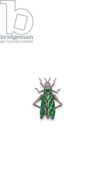 A Jadeite, Ruby and Coloured Diamond Brooch (jadeite, rubies & diamonds set in oxidised gold)