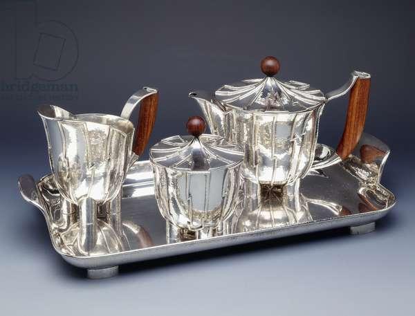 A Wiener Werkstatte hammered four-piece silver and teak tea-service, c.1927-8 (silver, teak)