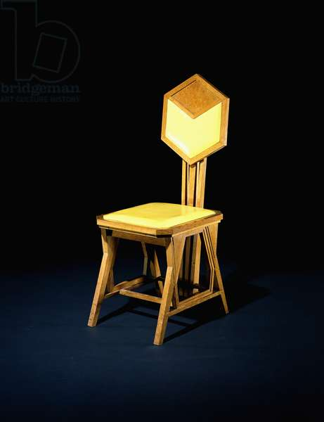 An oak side chair, designed by Frank Lloyd Wright (1867-1959) for the Imperial Hotel, Tokyo, c.1916-1922 (oak, yellow oil cloth)