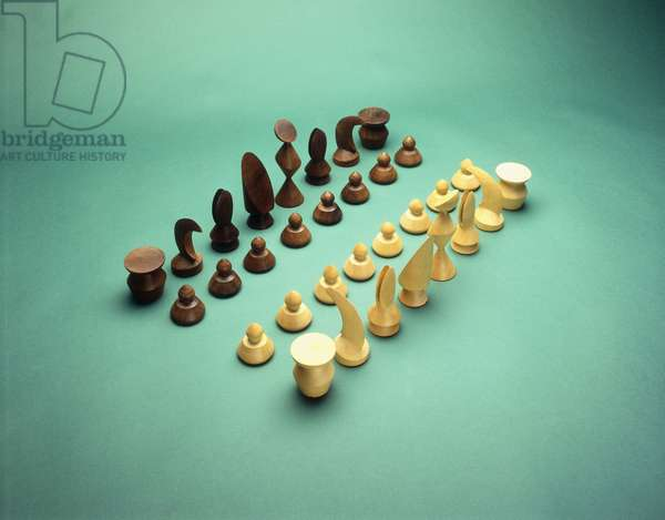 Chess set with sixteen teak and sixteen birch carved playing pieces, (oil on canvas)