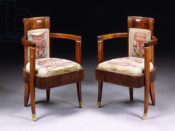 A pair of dining chairs from the oceanliner 'Normandie', c. 1934 (mahogany, brass, fabric)