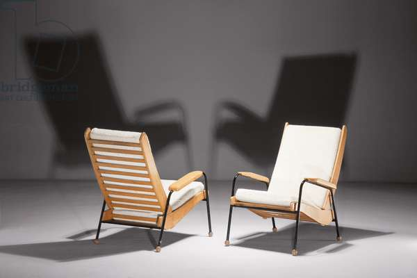 Pair of armchairs, designed c.1942, executed c.1946 (oak & lacquered steel)