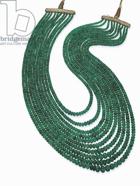 An impressive emerald bead necklace with ten graduated strands of emerald beads weighing approximately 1047 carats (emerald)