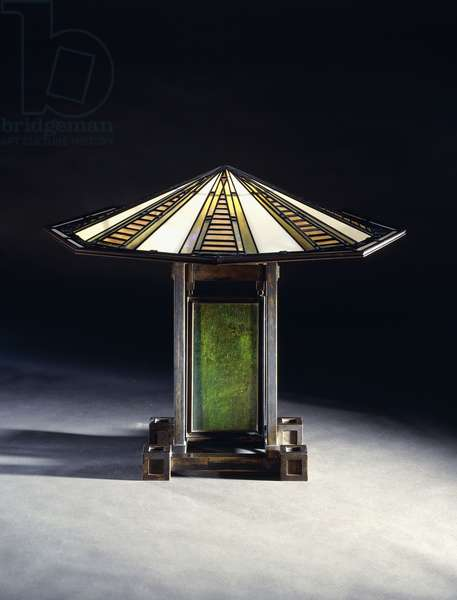A table lamp designed by Frank Lloyd Wright (1867-1959), and executed by the Linden Glass Co. for the Susan Lawrence Dana House, Illinois, c.1903 (leaded glass and bronze)