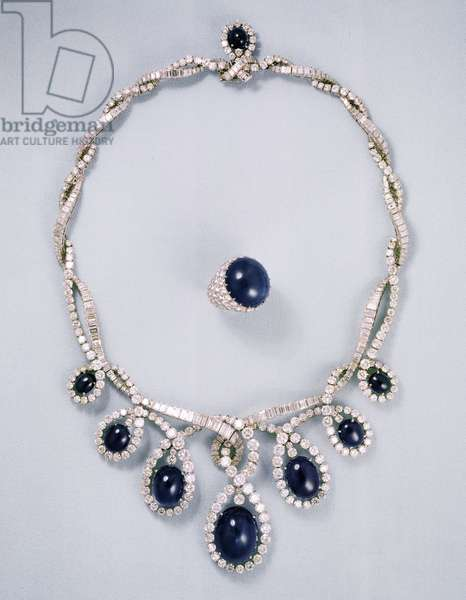 Diamond and sapphire necklace set with cabuchon sapphires; cabuchon sapphire and diamond ring