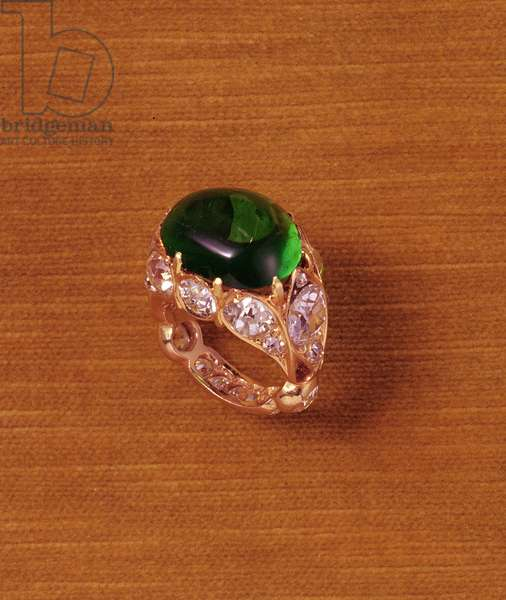 Claw-set cabochon emerald and diamond ring