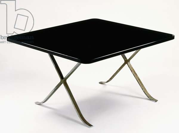 A Mies van der Rohe table with metal frame and glass top, 1929 (chromed metal, plate glass)
