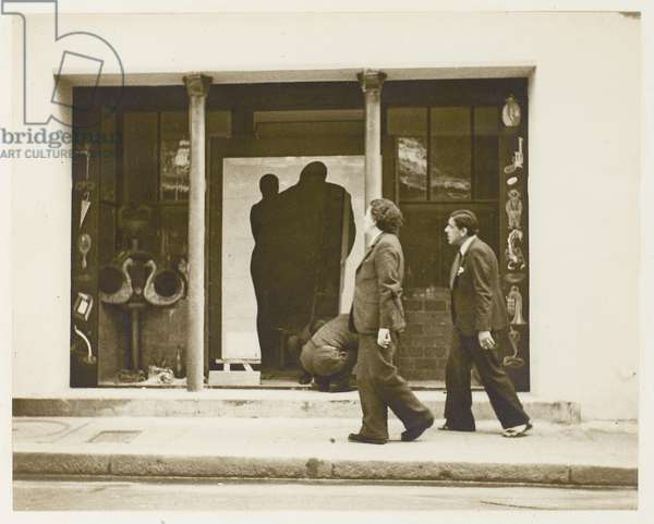Andre Breton and Oscar Dominguez discovering the trompe l'oeil entrance to the Gradiva Gallery, just as it is being installed by Marcel Duchamp, 1937 (b/w photo)