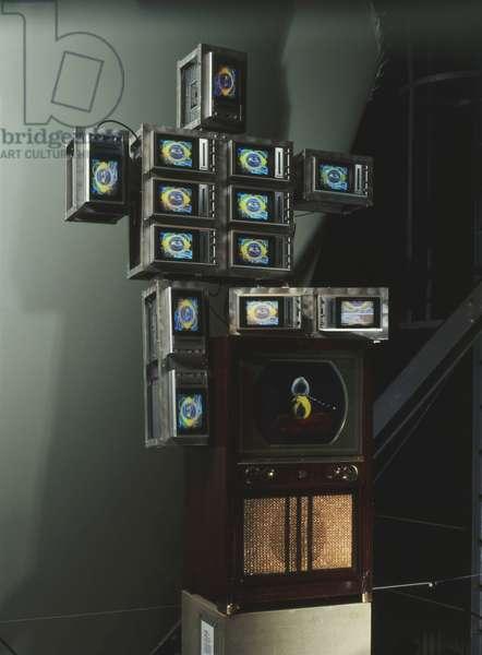 High Tech Baby, 1986 (13 colour tv sets, aluminium framework, tv cabinet screen, acryl)
