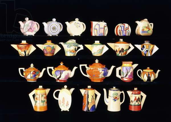 A selection of Clarice Cliff tea and coffee pots,  (ceramic)
