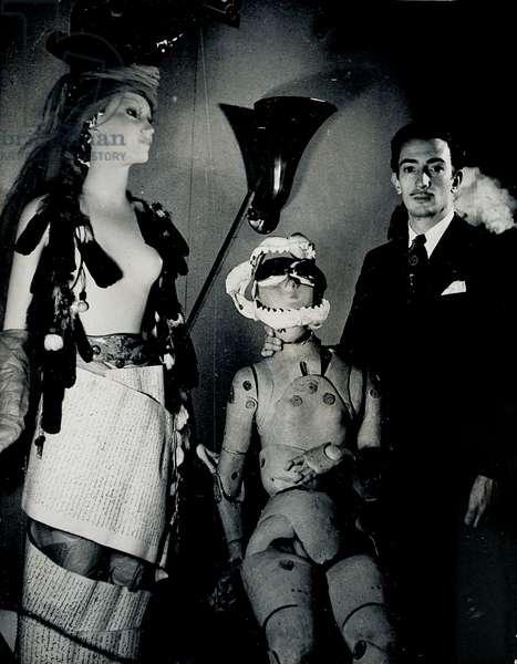 Salvador Dali with mannequins at the Surrealist Exhibition, Paris, 1938 (b/w photo)
