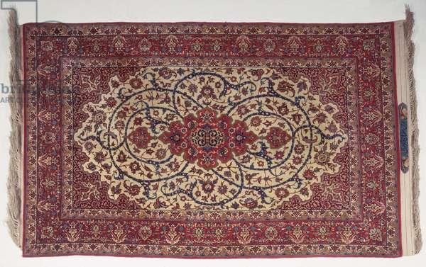 Part silk Isfahan rug with signature cartouche