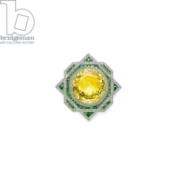 Belle Epoque pendant brooch, c.1915 (yellow sapphire, diamonds, demantoid garnet, platinum & gold)