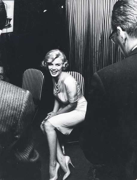 Marilyn Monroe seated in a restaurant, c.1955 (b/w photo)