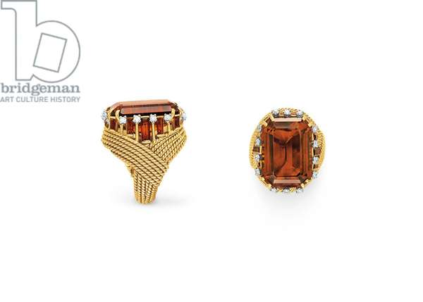 A citrine diamond and gold ring