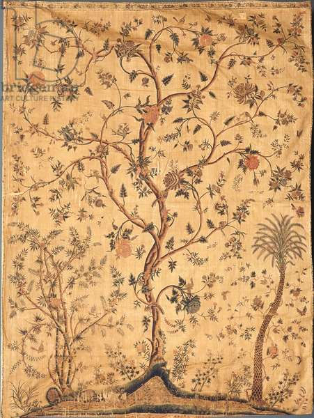 A palampore printed and painted with a central tree against a vermicular yellow ground