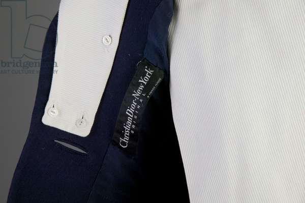 Close-up view of designer label inside jacket, 1951, Christian Dior-New York, New York