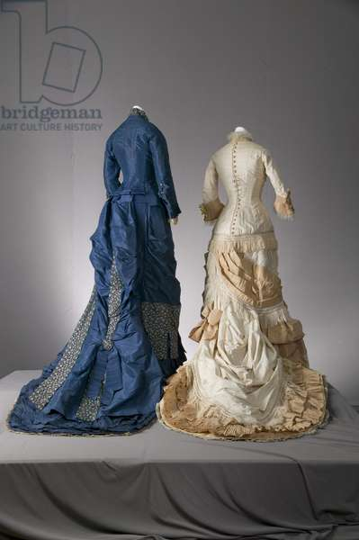 Wedding dress, 1877 (back view), Silk satin, silk jacquard, silk taffeta, silk fringe, silk lace, Field, Leiter & Co, Bridesmaid dress, 1879, Silk taffeta, brocade, lace, Maker unknown