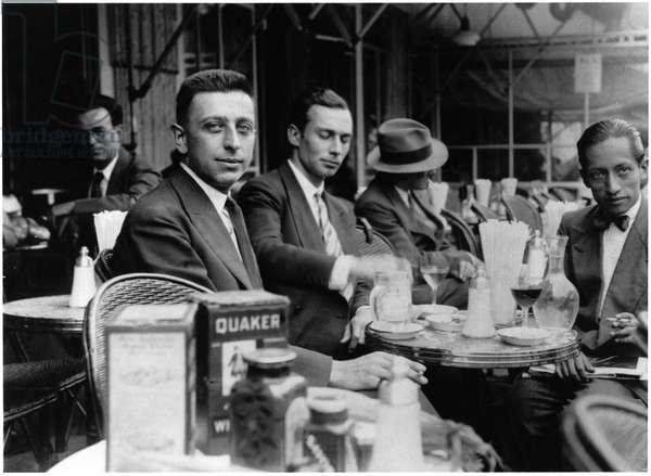 Robert Desnos (1900-45) on the terrace of Cafe Le Dome, Montparnasse, Paris (b/w photo)