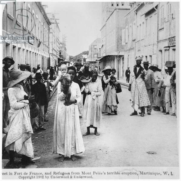 Street in Fort de France with refugees after the eruption of Mont Pelee, Martinique, published by Underwood and Underwood, 1902 (b/w photo)