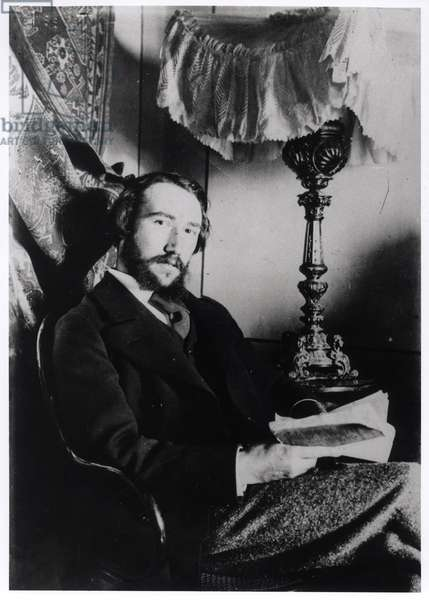 Portrait of Andre Gide (1869-1951) in his apartment in Paris, 1894 (b/w photo)