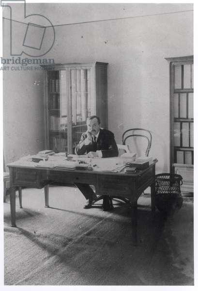 Paul Claudel (1868-1955) in his office in Prague (b/w photo)