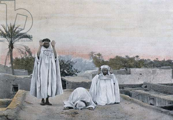 Muslim Prayers at Biskra in Algeria, early 20th century (colour litho)