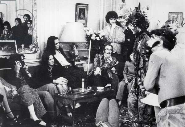 Salvador Dali, with entourage, c.1970  (b/w photo)