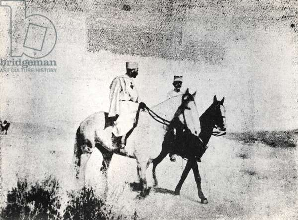 General Lyautey (1854-1934) and Father Charles Eugene de Foucauld (1858-1916) riding in Beni-Abbes (b/w photo)