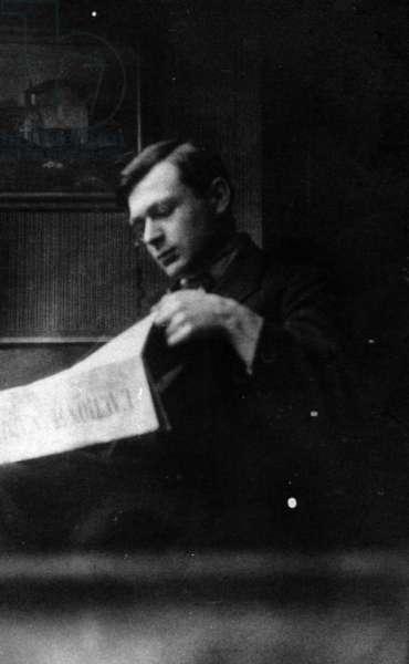 Tristan Tzara reading 'L'Action Francaise', c.1920-30 (b/w photo)