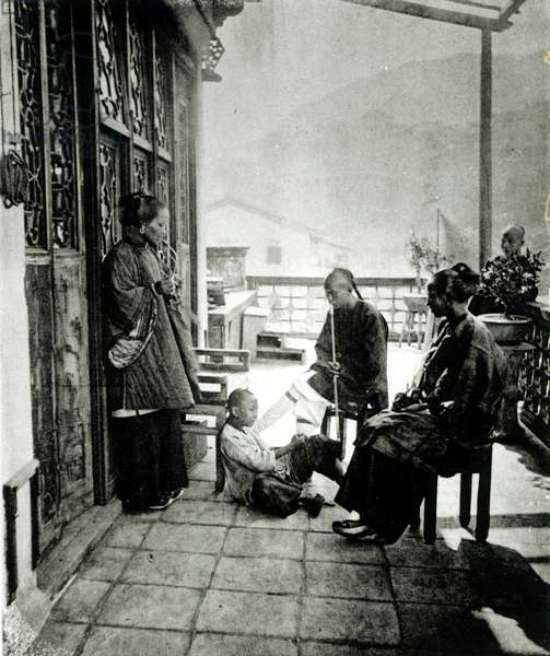 Chinese people smoking opium, from 'Illustrations of China and its people' by J. Thompson, published in London, 1873 (b/w photo)