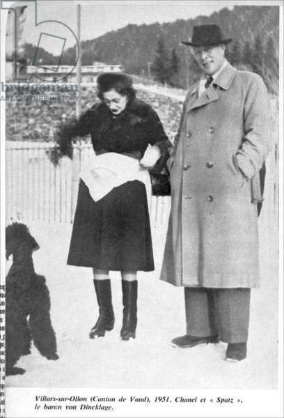 Coco Chanel (1883-1971) with 'Spatz' at Villars sur Ollon, Canton de Vaud, from 'Les annees Chanel' by Pierre Galante, Mercure de France, Paris Match, 1951 (b/w photo)